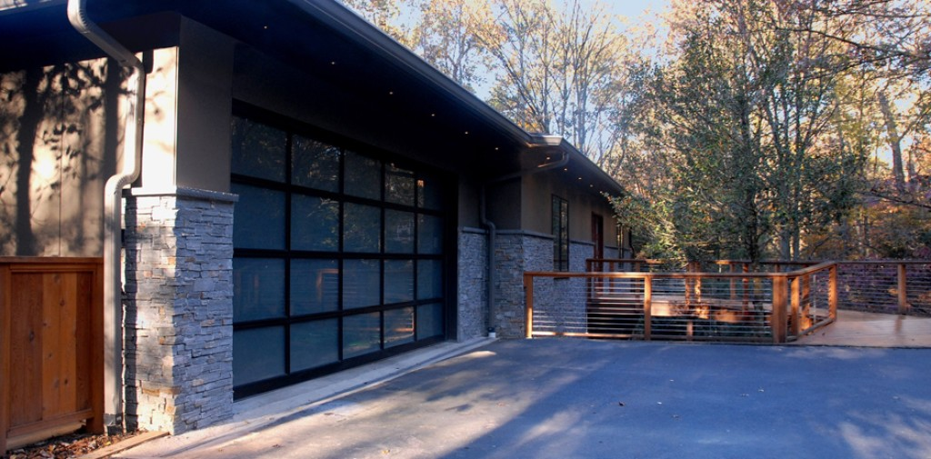 Home Remodeling Idea: New Glass Garage Door and Natural Wood Railings