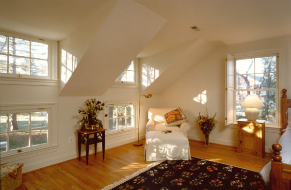 Attic master suite addition with sitting area, large bright; windows and sloped ceilings.