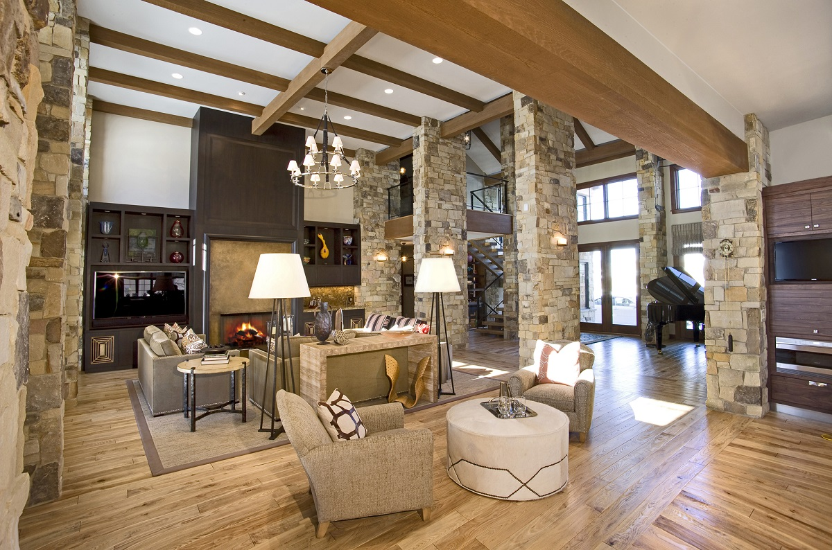 Great Room with Stone Columns and Light Wood Flooring